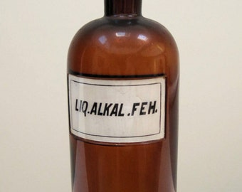 W T Co Antique brown apothecary bottle for Liq Alkal FEH