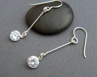 long silver dangles. cubic zirconia earrings. diamond alternative. clear crystals. simple jewelry. sterling silver drops. hook. 6 mm CZ