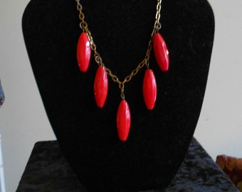 1930s bright pop color orange/red oval and brass necklace