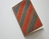 neon orange and blue stripes stitched moleskine notebook