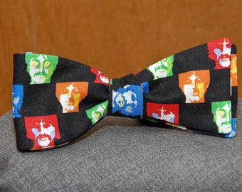 The Fab Four on Black  Bow Tie