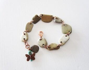 Beach stone bracelet.  Beige bracelet.  Copper bracelet.  Upcycled bracelet.  Lake Michigan. Adjustable length. Butterfly charm.