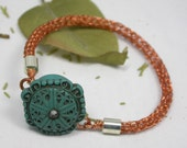 Copper Viking knit bracelet with polymer button magnetic Clasp