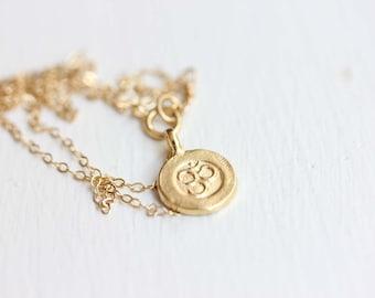 Om Symbol Charm Necklace