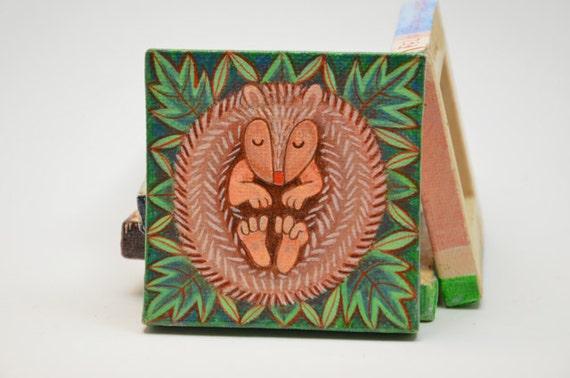 Tiny acryllic painting of a hibernating hedgehog