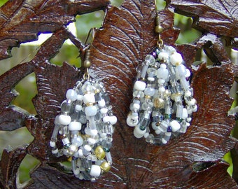 Opulent lush glass beaded loops of watery shades of gray, sea shell white, frosty sea glass, silver, gold, crystal, black & cobalt blue.....