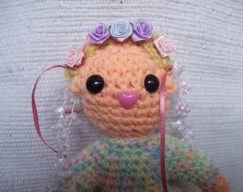 amigurumi ittle girl with flowered hair.doll.