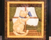 Quilted art by Fay-Cat looking out of window