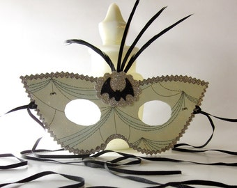 Spider Web Cats Eye Masquerade Ball Mask with Feathers and a Bat Black and Pale Blue Green