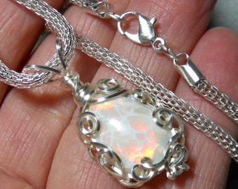 Exceptional  rolling red flash opal cabochon pendant, natural stone from Mexico, hand wrapped silver filigree setting