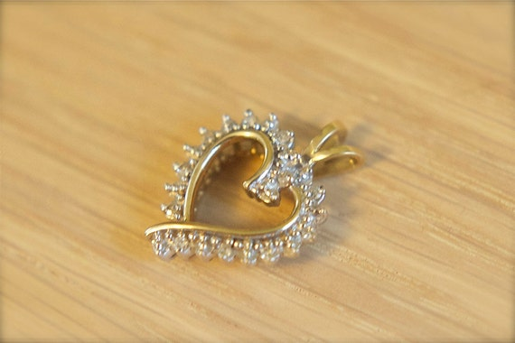 Reserved for Coatsnmore:  Vintage gold diamond heart pendant in 10k