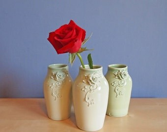 bud vase with rose in sping pea green