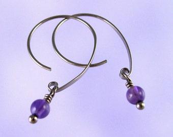 Niobium earrings: Amethyst beads on Apostrophe earwires