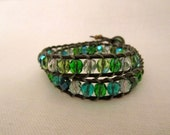 RESERVED FOR JULIE:  Green czech glass beaded leather wrap bracelet