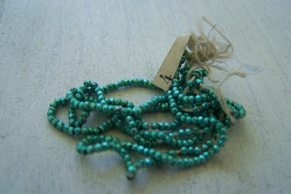 Antique French steel cut bead hank Partial   Tagged  Sea Foam green Rare color collectable Last One