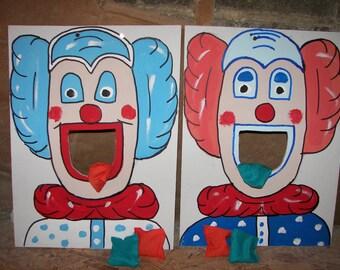 2 clowns  bean toss with  6  bean  bags