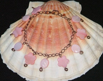 Pretty peach mother of pearl and  antiqued copper charm bracelet
