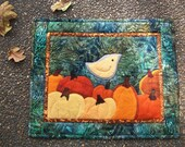 Pumpkin Patch landscape quilted wall hanging.