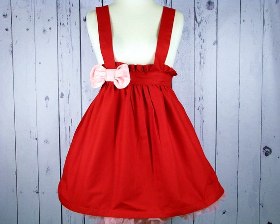 Hello Kittys Red Pinafore with a Baby Pink Bow size Med