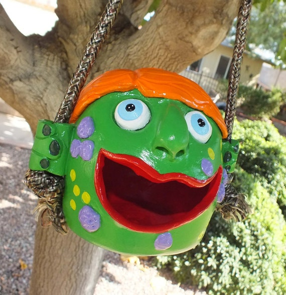 Ceramic Birdfeeder / birdhouse.  A friendly green Monster
