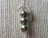 Custom peas in a pod necklace for April
