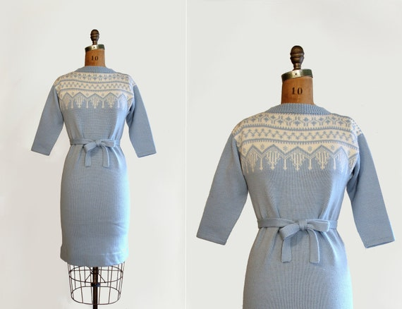 pale blue wool knit dress from the 1960's or 70s with white pattern and tied belt and 3/4 length sleeve