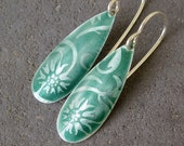 Enamel earrings in silver and dark green enamel, floral, dangle.