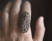 Hive - A funky porcelain ring on adjustable band...for the natural history lover.