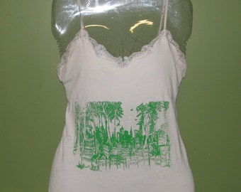 medium white tank top, forest wins on front, flying forest defender on back
