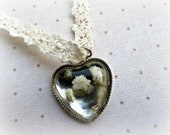 Resin with real flowers heart  pendant on crochet or lace necklace