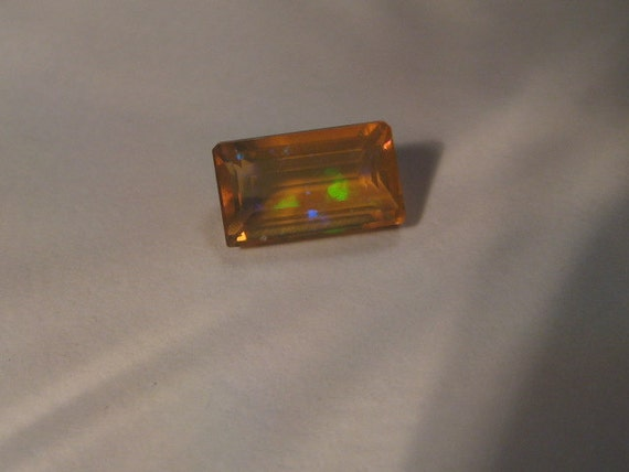 faceted Ethopian Opal  ....   8 x  5  x  4.mm .........            2088