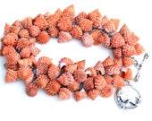 eco friendly strawberry cone bracelet. wire wrapped seashell bracelet. peach or burnt orange mermaid clasp. eco nautical jewelry