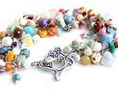 uniquenecks bracelet. sterling silver wire wrapped handmade beaded bracelet soft colors wrapped gemstone beads bracelet