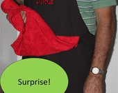Kiss the Cook, in heat pressed vinyl.  Towel may be black if red not avaliable.  Mature content