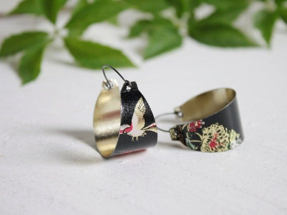 Black earrings made from a vintage tea tin