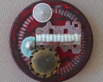 Medallion: found object assemblage