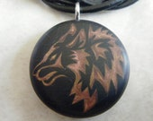 Copper Wolf  hand carved Pendant on a black color background. Pendant comes with a FREE 3 mm leather Necklace