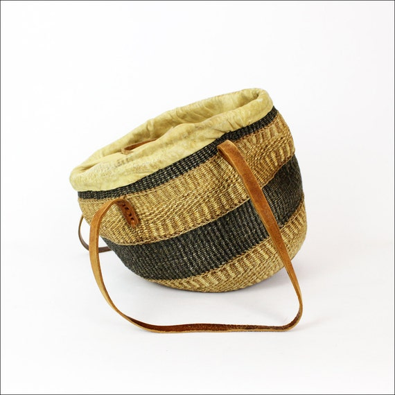 striped straw bag with leather cinch closure