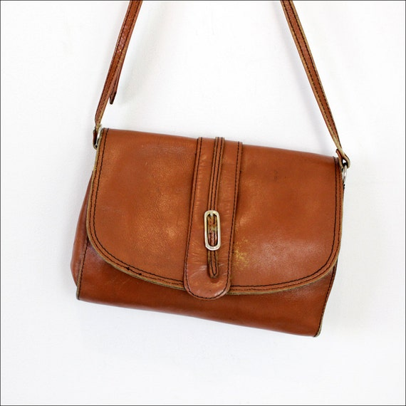 rust leather satchel / distressed 80s shoulder bag