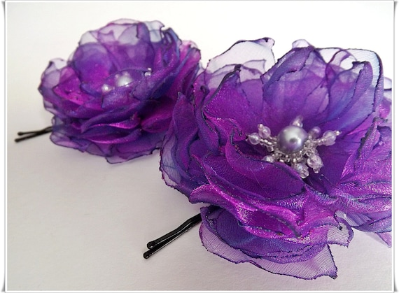 Purple bobby pins, purple flower pins, flower hair accessories.