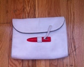 Convertible Krizia designer clutch/shoulder bag.  White with cool red clasp detail. Made in Italy.