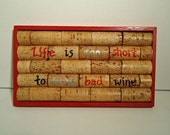 """Upcycled Wine Cork Trivet with wooden base (red) - """"Life is too short to drink bad wine"""""""