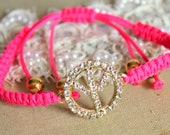 Friendship bracelet pink neon braided with real peace sighn swarovski rhinestones .