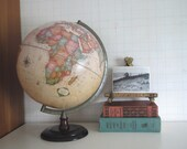Vintage Cram's Globe..........soft aged pastels..........wood base......metal axis