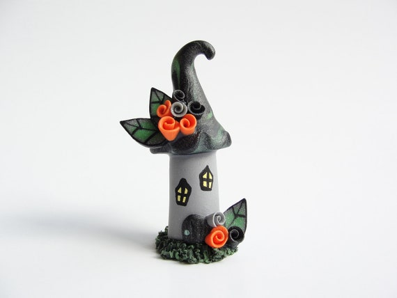 Miniature haunted house fairy cake topper for Halloween made from polymer clay in black and orange