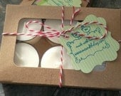 Quebec sugarbush soy candle tealights . Packaged beautifully.