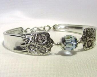 Handmade silverware bracelet in the April pattern, circa 1950, with a Swarovski crystal bead in blue denim