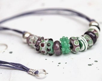 Funky lampwork necklace. Mint green and violet