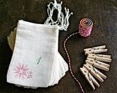 Advent calendar kit.  Muslin favor bags, 3x5.  Set of 24 in green and red, plus baker's twine and clothespins for display.