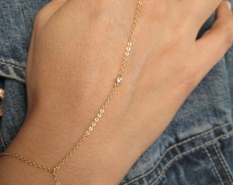Gold chain slave bracelet with tiny cubic zirconia with chain ring finger Kardashian inspired. G2124